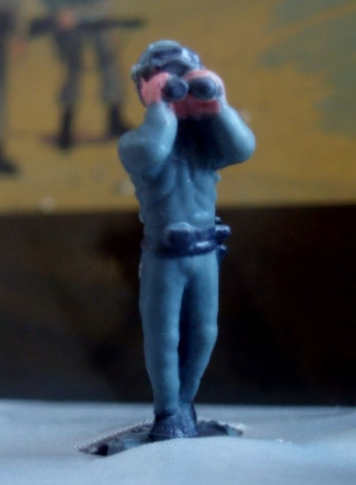 A soldier with binoculars. From 94' Micro Machines #17 Infantry Attack set.