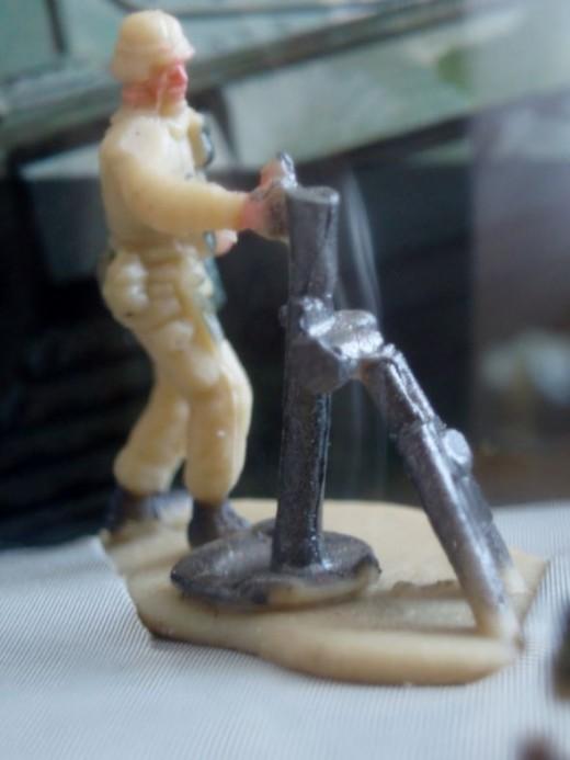 A soldier firing mortar. From 94' Micro Machines #17 Infantry Attack set.