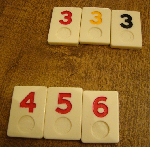 Sets (3, 3, 3) must be of different colors.  Runs (4, 5, 6) must all be of the same color.
