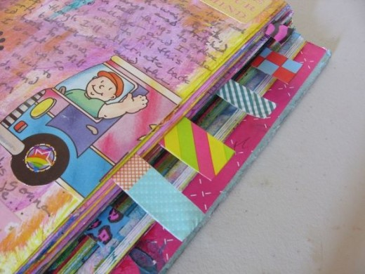 Bookmark the most important entries n your art dournal with washi tape tabs