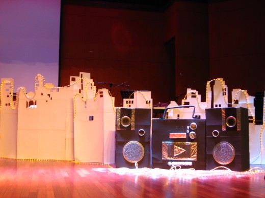 "The stage props are all recycled from carton boxes and cardboards. Thanks to a team of ingenious friends. We managed to produce the entire ""cityscape & the mini combo"" over a spend of 3 weekends!"