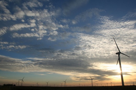 An Iowa wind farm at sunset. Photo by 2neus.