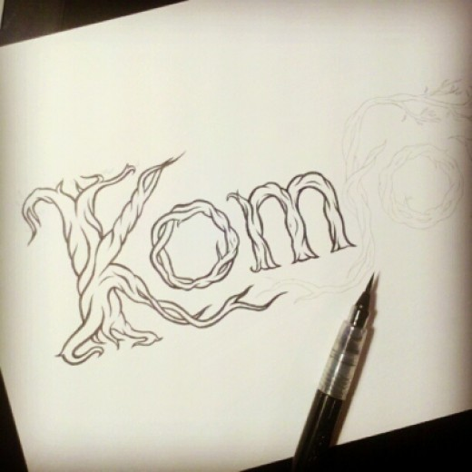 Inking a hand-lettered logo with a brush pen