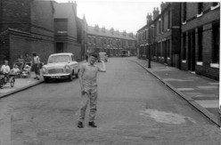 This was taken in our street and you can see what two up two down housing looked like in the 1950s