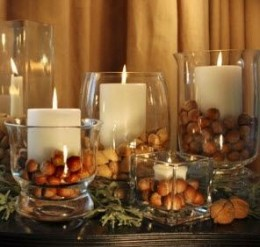 Candles and nuts in a clear glass candle holder from eleganteventdesign.com