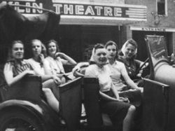 Local gals in from of the Franklin Theatre. Circa 1939