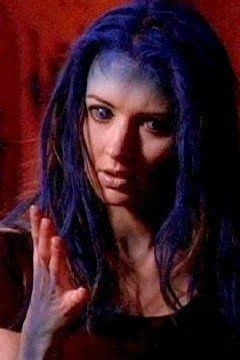 Illyria emerges from the shell and examines her new blue form
