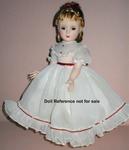 This was a typical dress for a doll in 1948.  Yes, there were baby dolls.  They came with a cloth diaper and a whole in their mouth to either suck their thumb or stick the bottle in.  No real fluid was used, and they hadn't come up with the false liq