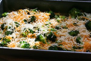 Put the broccoli mix below and grate cheese on top