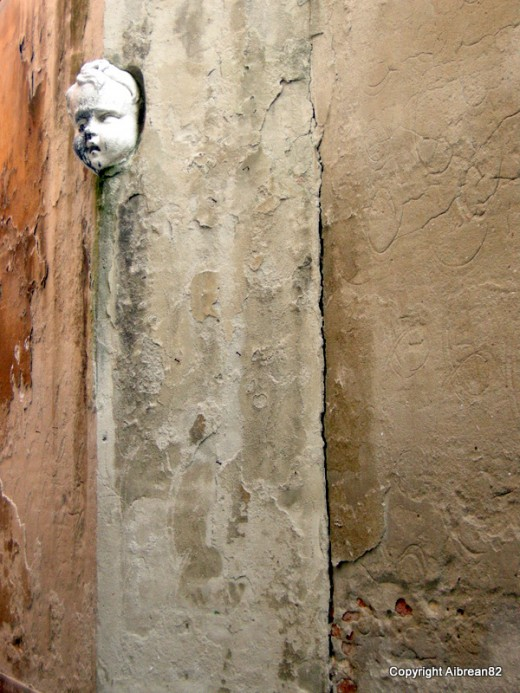 I saw this in a narrow alleyway in Venice. I found it very odd and interesting.