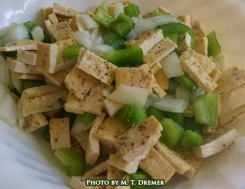 The seasoning powders you use are adaptable to almost any dish. Here the finished strips are pictured with chopped green peppers and onions.