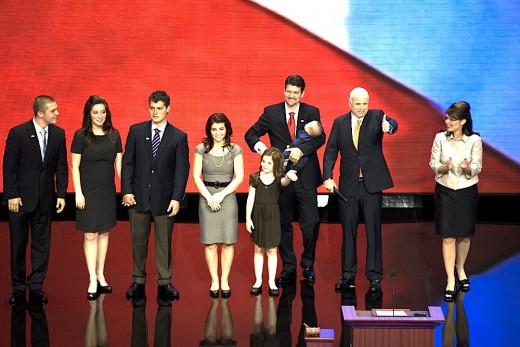 From left:  Track Palin, Bristol Palin, Levi Johnston (Bristol's ex), Willow Palin, Piper Palin, husband Todd Palin holding Trig Palin, John McCain, and finally Sarah Palin.