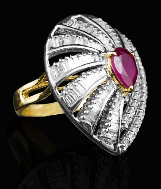Ruby ring with diamond studded in gold