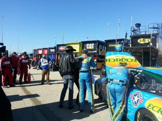 The King consoles Aric Almirola after the driver exited early due to a blown engine