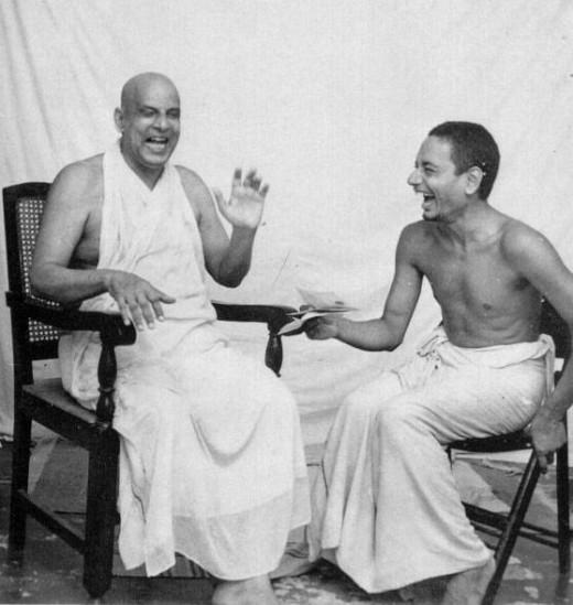 Swami Sivananda shares a joke with his disciple, Swami Venkateshananda