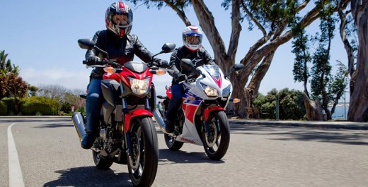 The CB300F is the red motorcycle in the foreground, while the CBR300R is the red, white, and blue, motorcycle in the background