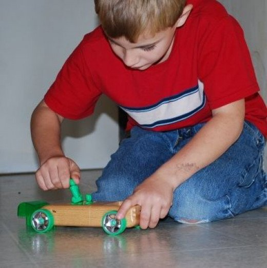 Child Playing with Automoblox Truck Toy