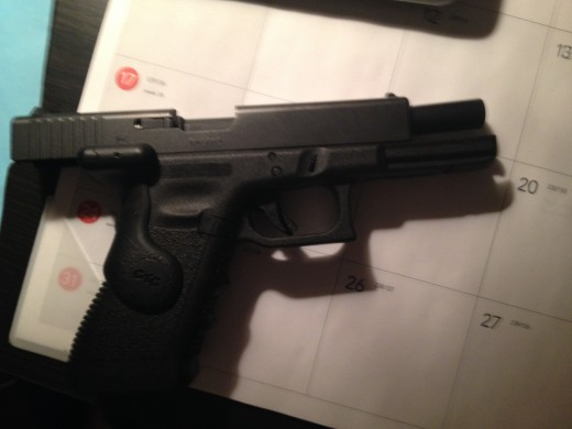 Glock 17 with an empty magazine (slide locks back) Pretty obvious, right?