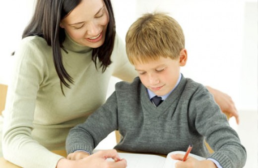 A teacher tutoring a boy