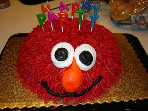 Fuzzy Elmo cake by hello-julie http://www.flickr.com/photos/roosterfarm/113600792/