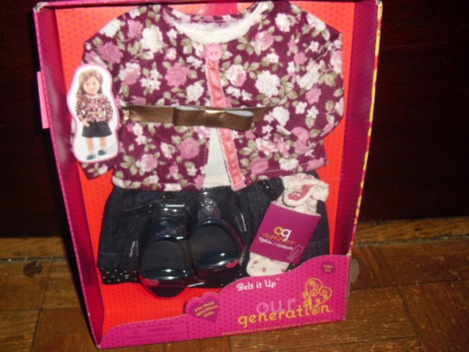 The 'Our Generation' outfit is for the younger girl's eighteen-inch-doll.