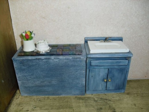 Here is the miniature cabinet in its current incarnation, sporting an antiqued blue finish.