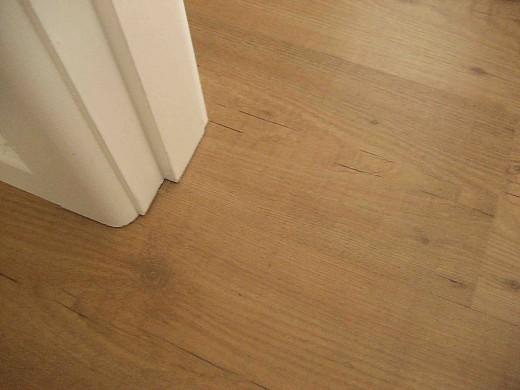 Hardwood Laminate Flooring under the Door Post