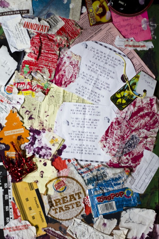 A collage inspired by Kurt Schwitters, made of collected garbage, poems, a Moazart CD, and whatever else I could find on the ground.