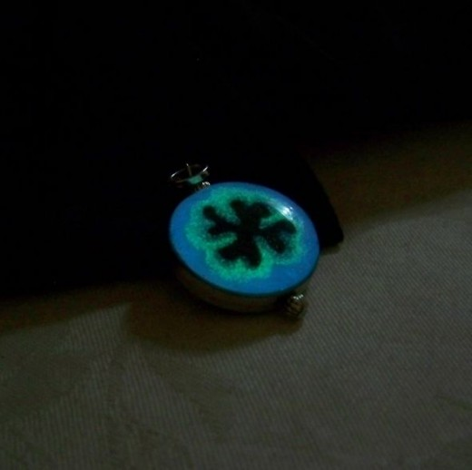Everyone needs a good luck charm!  Bezel set, completely handmade, and two different glow effects!  Check us out on Etsy www.etsy.com/shop/clover13