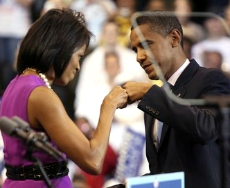 MICHELLE AND PRESIDENT BARACK OBAMA FIST BUMP DURING HIS PRESIDENTIAL CAMPAIGN.