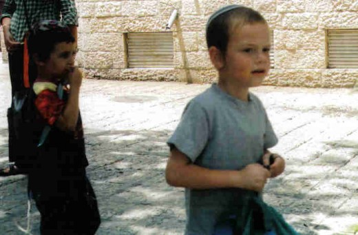 Jewish boy with side curls (peyoys)and Yarmulk or Kippa in the Jewish Quarter of the Old City of Jerusalem