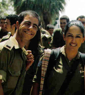 Two young soldiers who are in training for the Israeli Defense Forces.  They are right out of highschool.