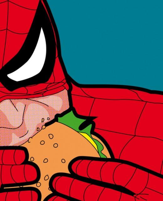 Spiderman enjoying a big bite of his burger.