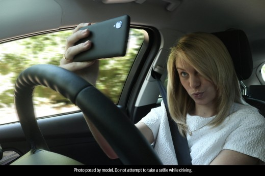 "The caption says, ""Photo posed by model. Do not attempt to take a selfie while driving."" Isn't it kind of sad that the caption needs to tell people that?"