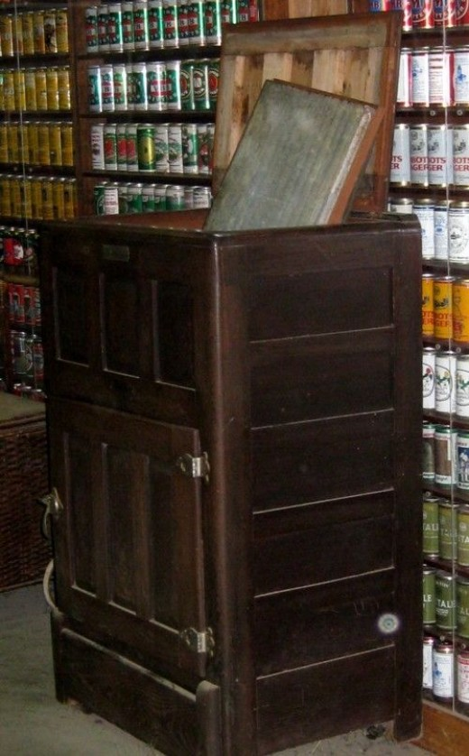 A block of ice was delivered daily and put in the top of this early 'refrigerator', and food put in the cabinet below.The Iceman Cometh?