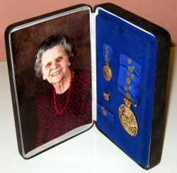 Don't you love the photo opposite the award? That's exactly how it looks, in its leather holder.