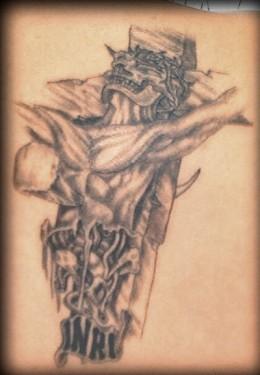 Bizarre Cross Tattoo