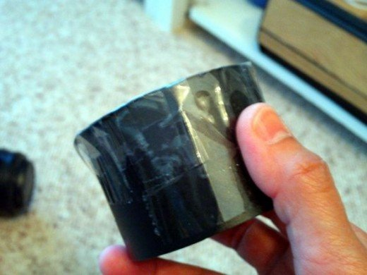 tape the lens cap onto the side strip