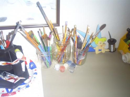 I use old mason jars to store my paint brushes.