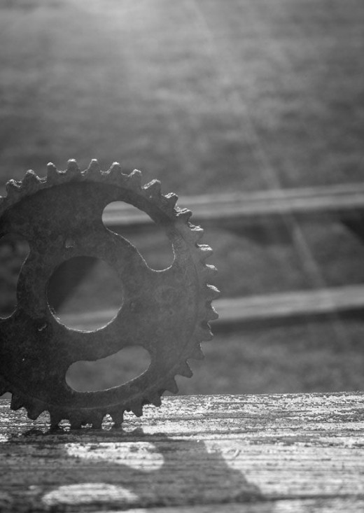 rusty-gear-on-wooden-table-at-sunrise