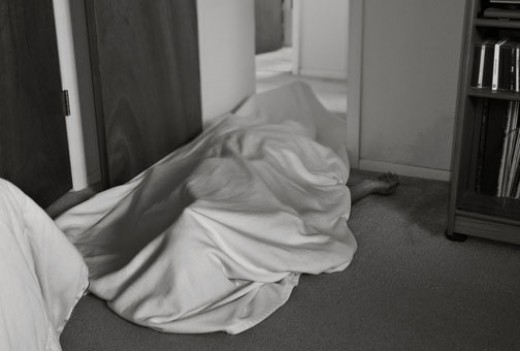 Body Covered With Sheet (Photo by Daniel Oines / flickr.)