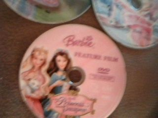 Some of the movies in her Barbie movie DVD collection.