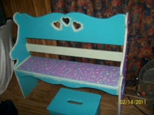 Colorful painted wood furniture for the girl's bedroom is a great idea especially, when they help do the painting.