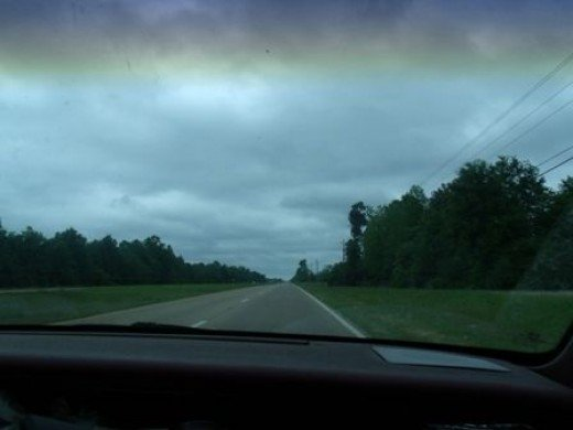 Riding down the highway looking out the front window of my car - a 1991 Buick Regal Custom 3800 Limited Edition Recall.