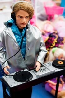 Barbie Dream House doll Ken making music.