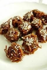 Bukayo is made by simmering strips of young coconut (buko) in water and then mixing with brown sugar .