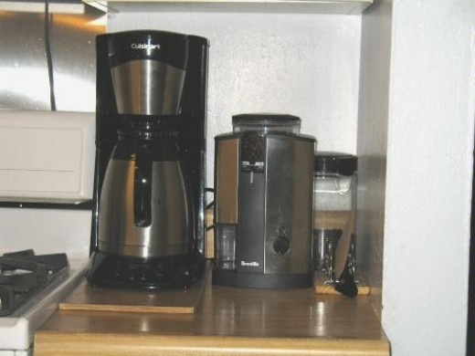 A Breville grinder on the kitchen counter (right).