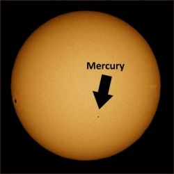 The Historical Transit of Mercury on Novermber 8, 2006. Mercury is the small black dot in the lower middle of   the solar disk. The dark spot on the left-hand side is a sunspot. (Image: Brocken Inaglory)