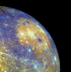 False-color image of Mercury taken by MESSENGER Wide Angle Camera (WAC) on January 14, 2008, shows the   Caloris Basin, visible as a large, circular, orange feature in the center of the image. (Image: NASA/Johns Hopkins   University APL/Arizona State