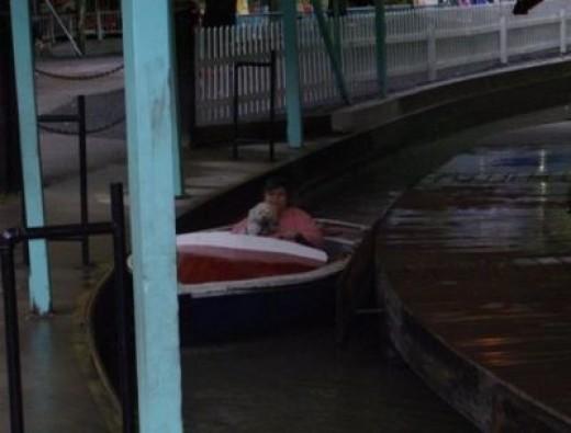 Mama and I riding the boats.